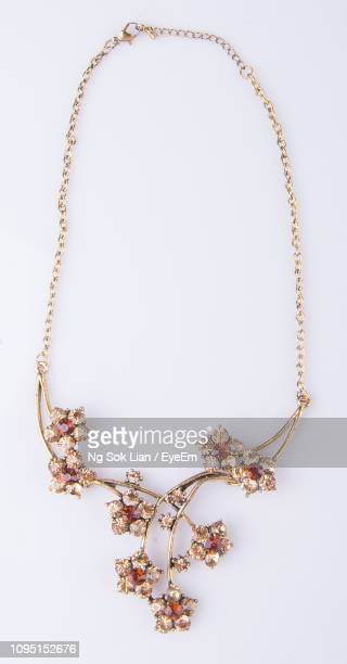 close-up of necklace against white background - necklace stock pictures, royalty-free photos & images