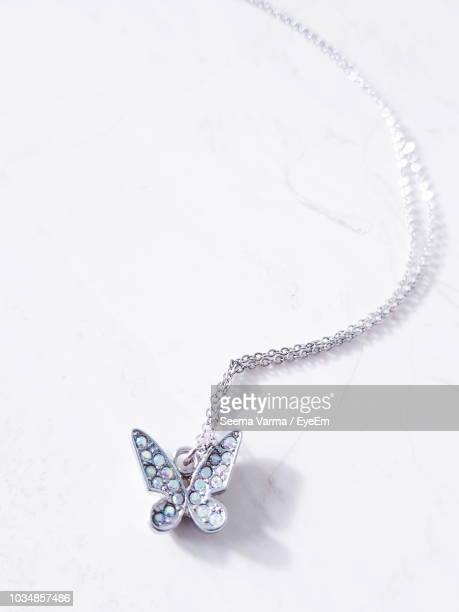 close-up of necklace on white background - choker stock photos and pictures