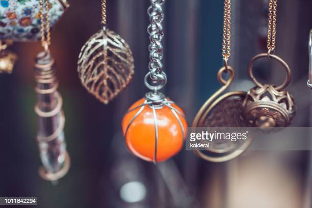 close-up of necklaces for sale - pendant stock pictures, royalty-free photos & images