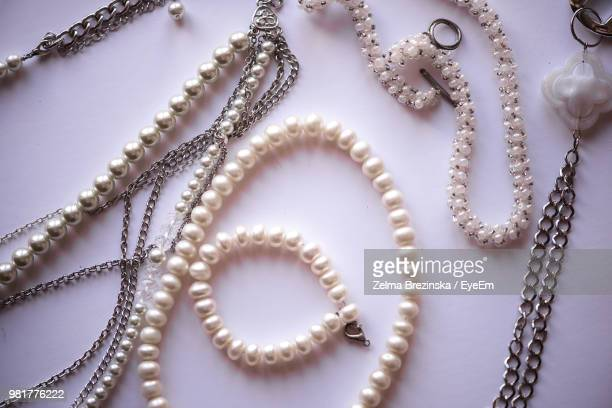 Close-Up Of Necklaces On Pink Background
