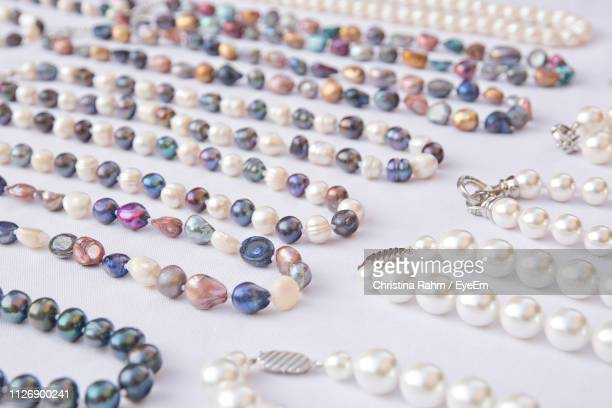 close-up of necklaces on white table - palma majorca stock pictures, royalty-free photos & images