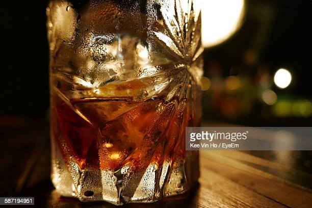 Close-Up Of Negroni Cocktail In Glass