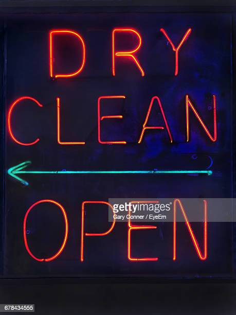 close-up of neon sign board at night - neon letters stock photos and pictures