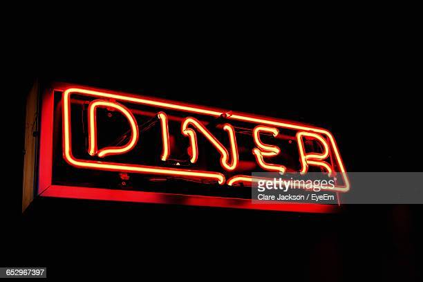 Close-Up Of Neon Sign On Black Background