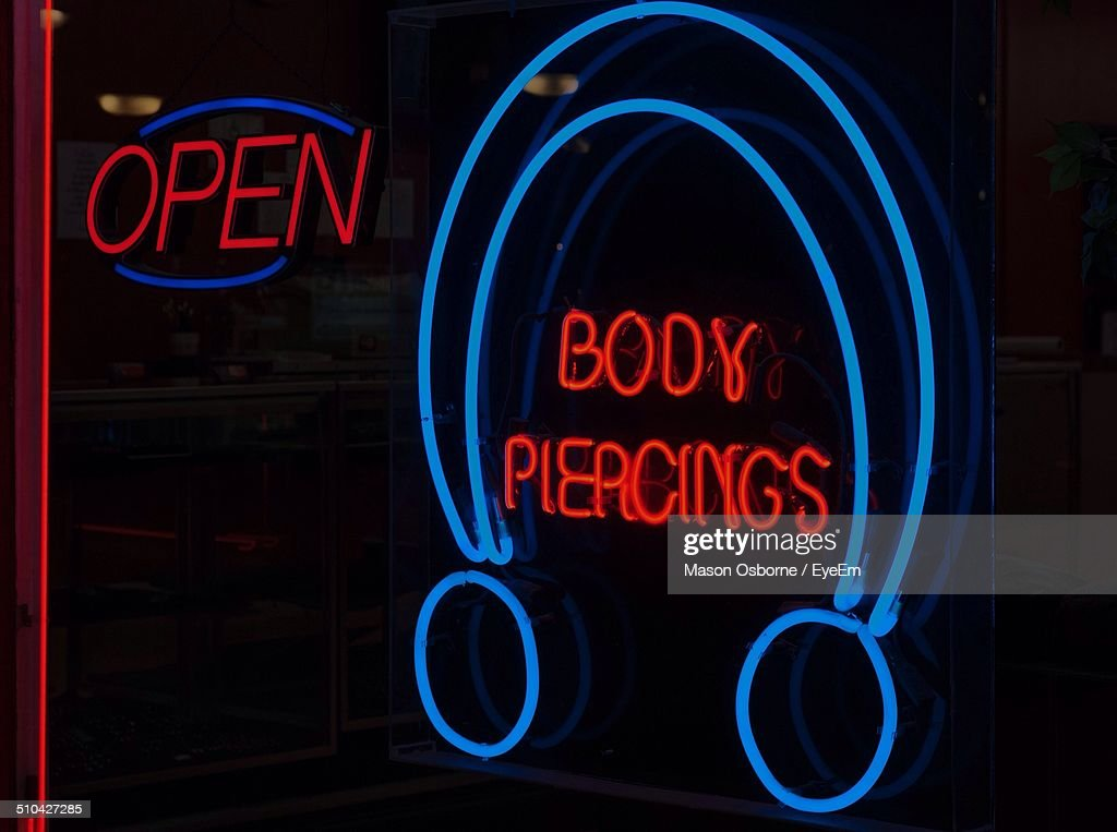 Close-up of neon signs over black background : Stock Photo