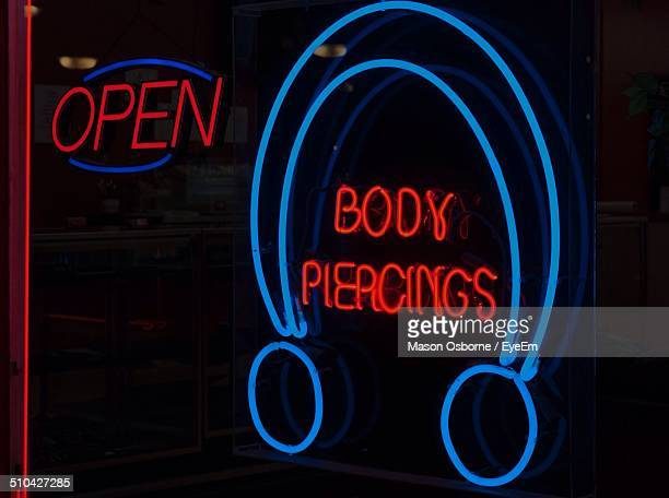 Close-up of neon signs over black background