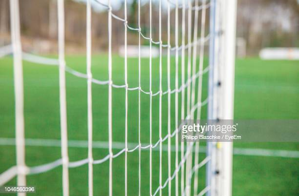 close-up of net at soccer field - soccer goal stock pictures, royalty-free photos & images