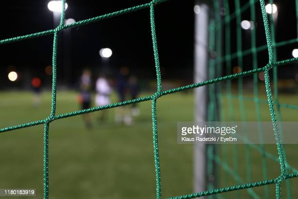 close-up of net on goal post in stadium - goal sports equipment stock pictures, royalty-free photos & images