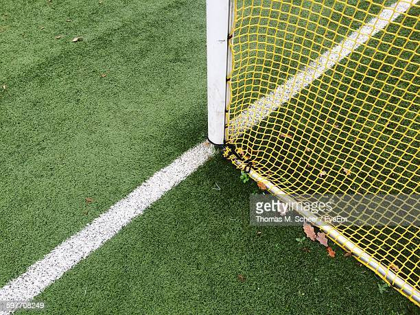 close-up of net on soccer field - netting stock pictures, royalty-free photos & images