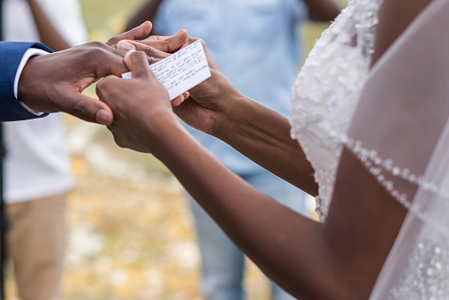 Close-up of Newlywed couple Exchanging Rings at Wedding Ceremony - gettyimageskorea