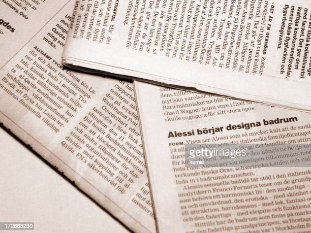 Close-up of newspaper in different languages