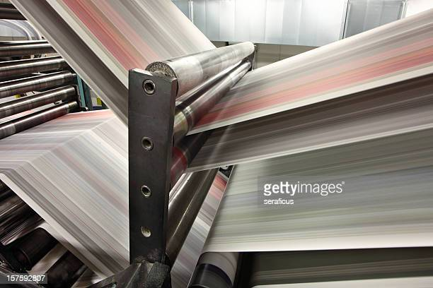 Close-up of newspapers printing in action