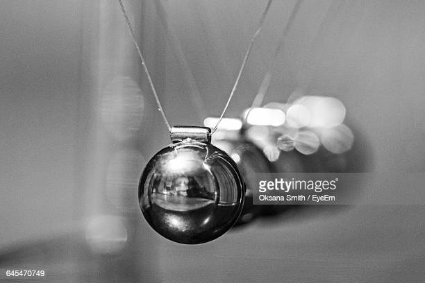 close-up of newton cradle - desk toy stock photos and pictures
