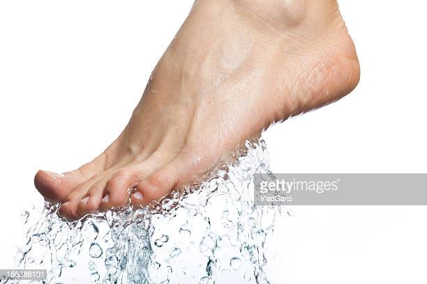 closeup of nice wet legs - pretty toes and feet stock photos and pictures