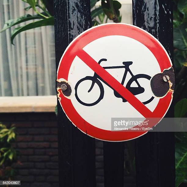 Close-Up Of No Cycling Sign On Gate