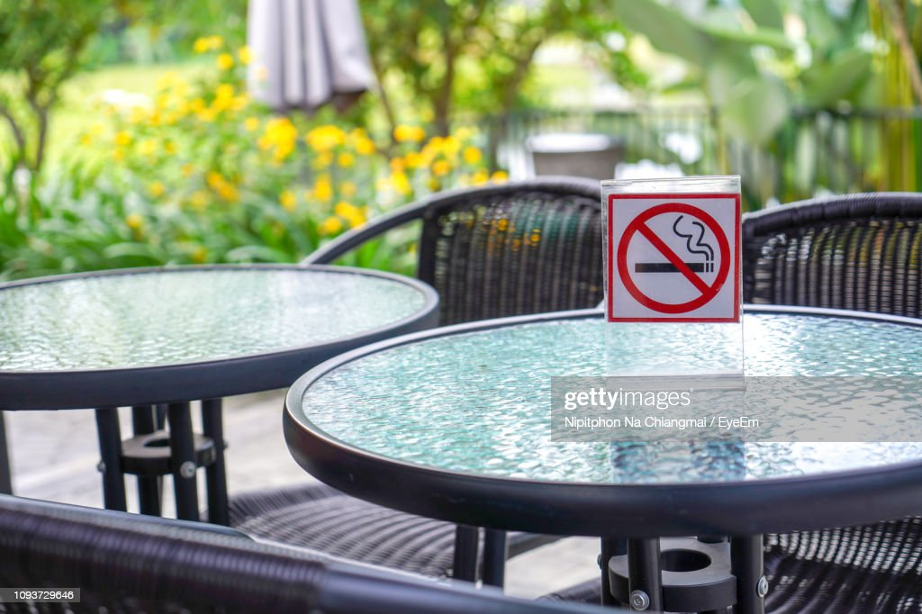 Close-Up Of No Smoking Sign On Table At Cafe : Stock Photo