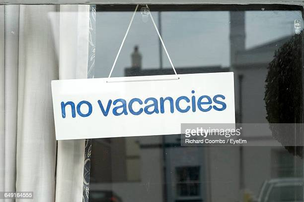 Close-Up Of No Vacancy Sign On Window