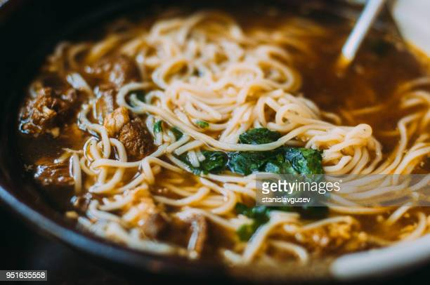 Close-up of noodle and beef broth
