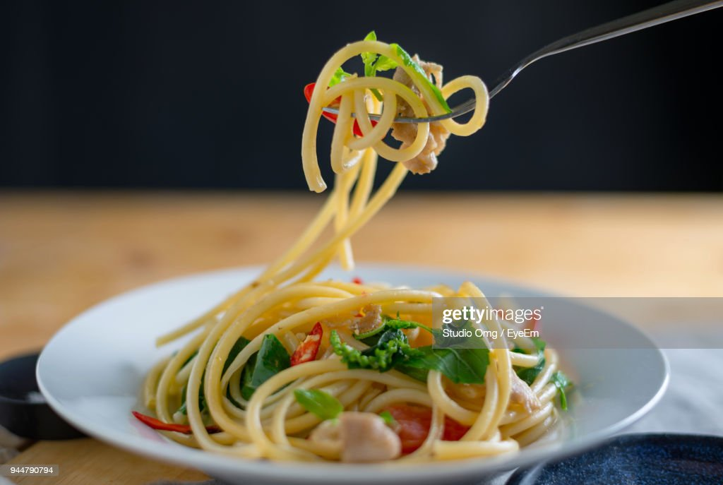 Close-Up Of Noodles Served On Table : Stock Photo