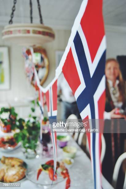 Close-Up Of Norwegian Flag Hanging Over Dining Table