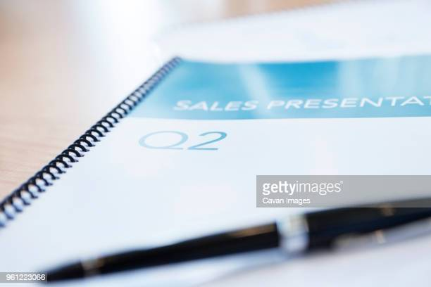 Close-up of note pad and pen on table
