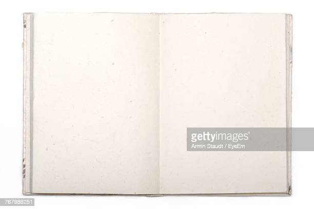 close-up of note pad over white background - dagboek stockfoto's en -beelden