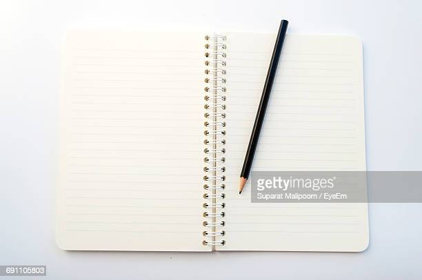 close-up of notebook - workbook stock photos and pictures