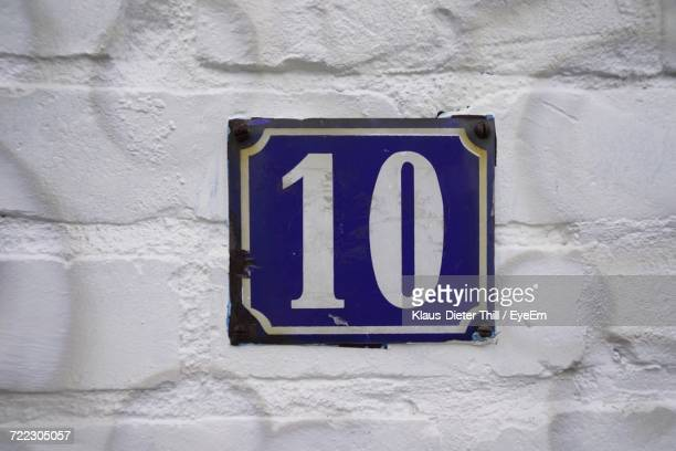 Close-Up Of Number 10 On Metal At Wall