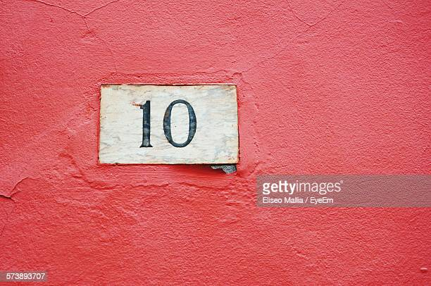 Close-Up Of Number 10 On Red Wall