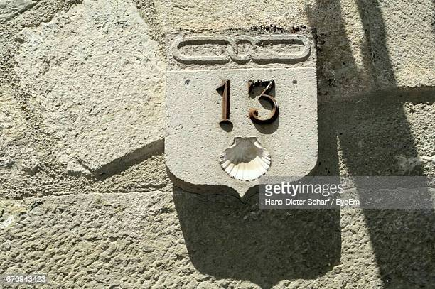 Close-Up Of Number 13 On Concrete Wall