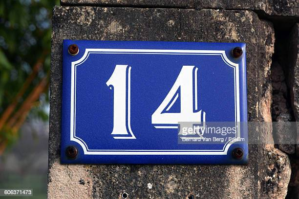 close-up of number 14 board mounted on wall - number 14 stock photos and pictures