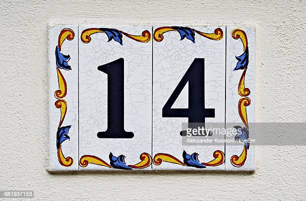 close-up of number 14 on wall - number 14 stock photos and pictures