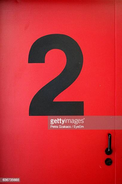 Close-Up Of Number 2 On Red Door