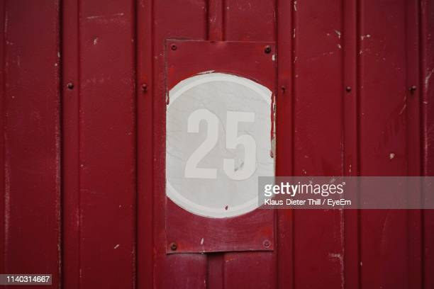 Close-Up Of Number 25 On Red Wall