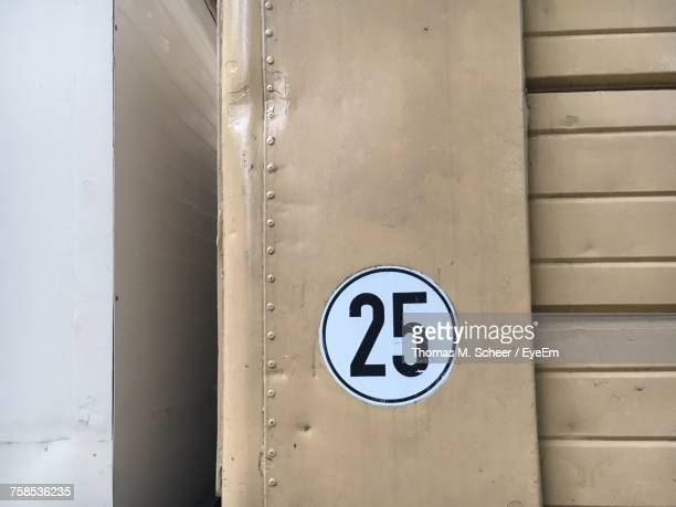 Close-Up Of Number 25 On Shutter