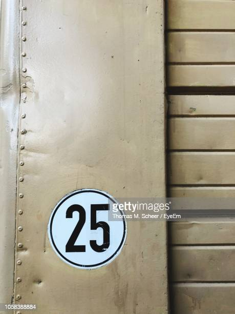 Close-Up Of Number 25 On Wall