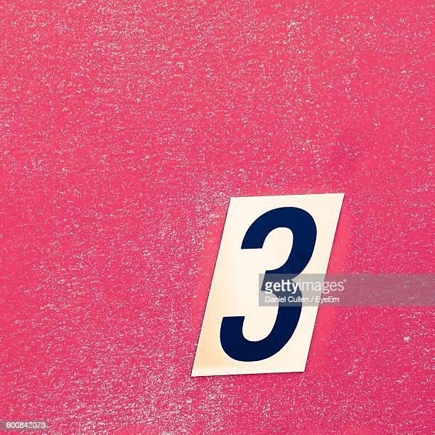close-up of number 3 on red wall - number 3 stock pictures, royalty-free photos & images