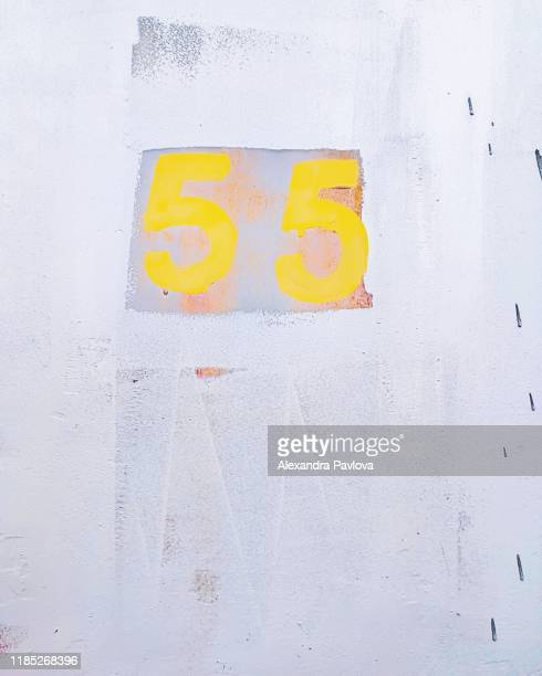 close-up of number 55 in bright colors on a wall / door - alexandra blanc photos et images de collection