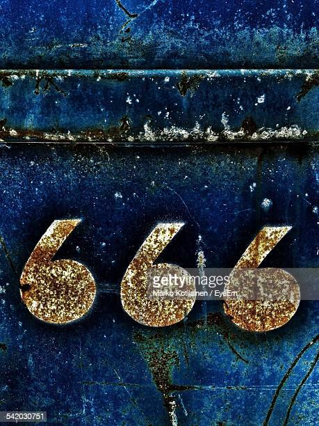 Close-Up Of Number 666 On Rusty Metal