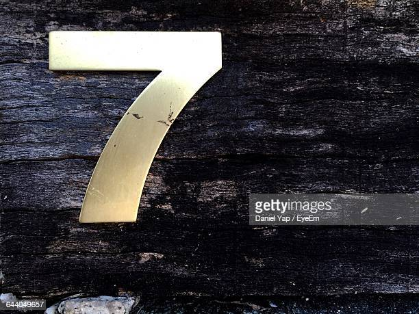 Close-Up Of Number 7 On Wooden Door