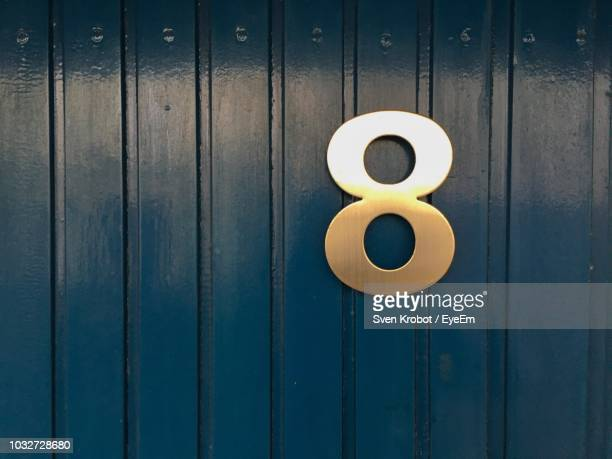 Close-Up Of Number 8 On Wooden Door