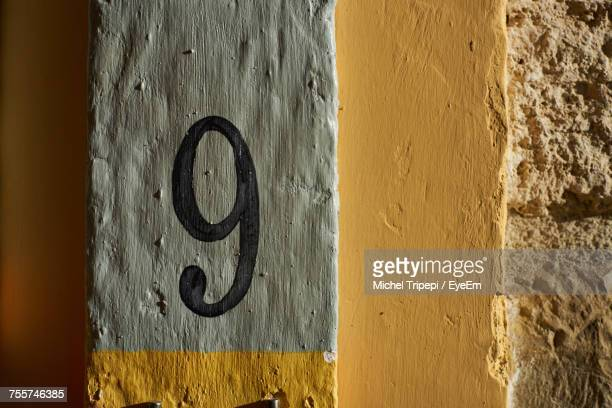 Close-Up Of Number 9 On Wall