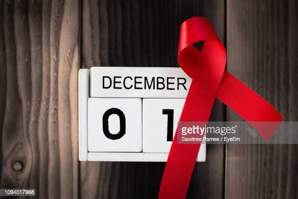close-up of number and ribbon on wood - world aids day stock pictures, royalty-free photos & images