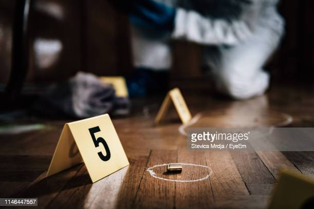 close-up of number at crime scene - crimine foto e immagini stock