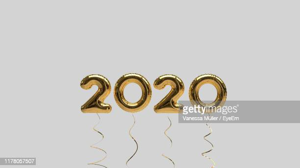 close-up of number balloons against gray background - 2020 stock pictures, royalty-free photos & images