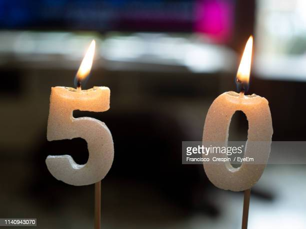 close-up of number burning candles - number 50 stock pictures, royalty-free photos & images