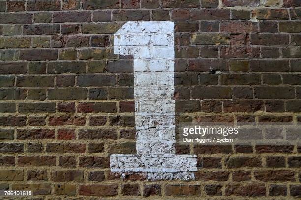 Close-Up Of Number On Brick Wall