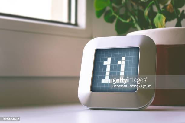 close-up of number on digital display at table - 数字の11 ストックフォトと画像