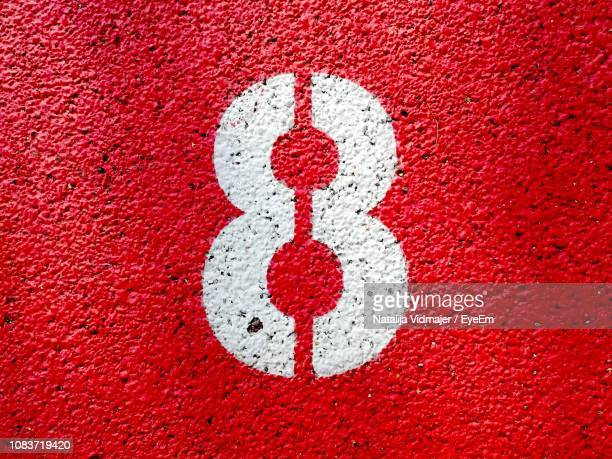 close-up of number on wall - number 8 stock pictures, royalty-free photos & images