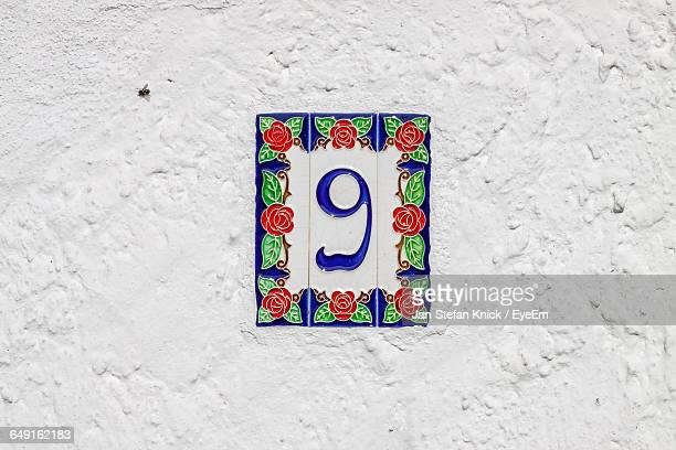 Close-Up Of Number On White Wall